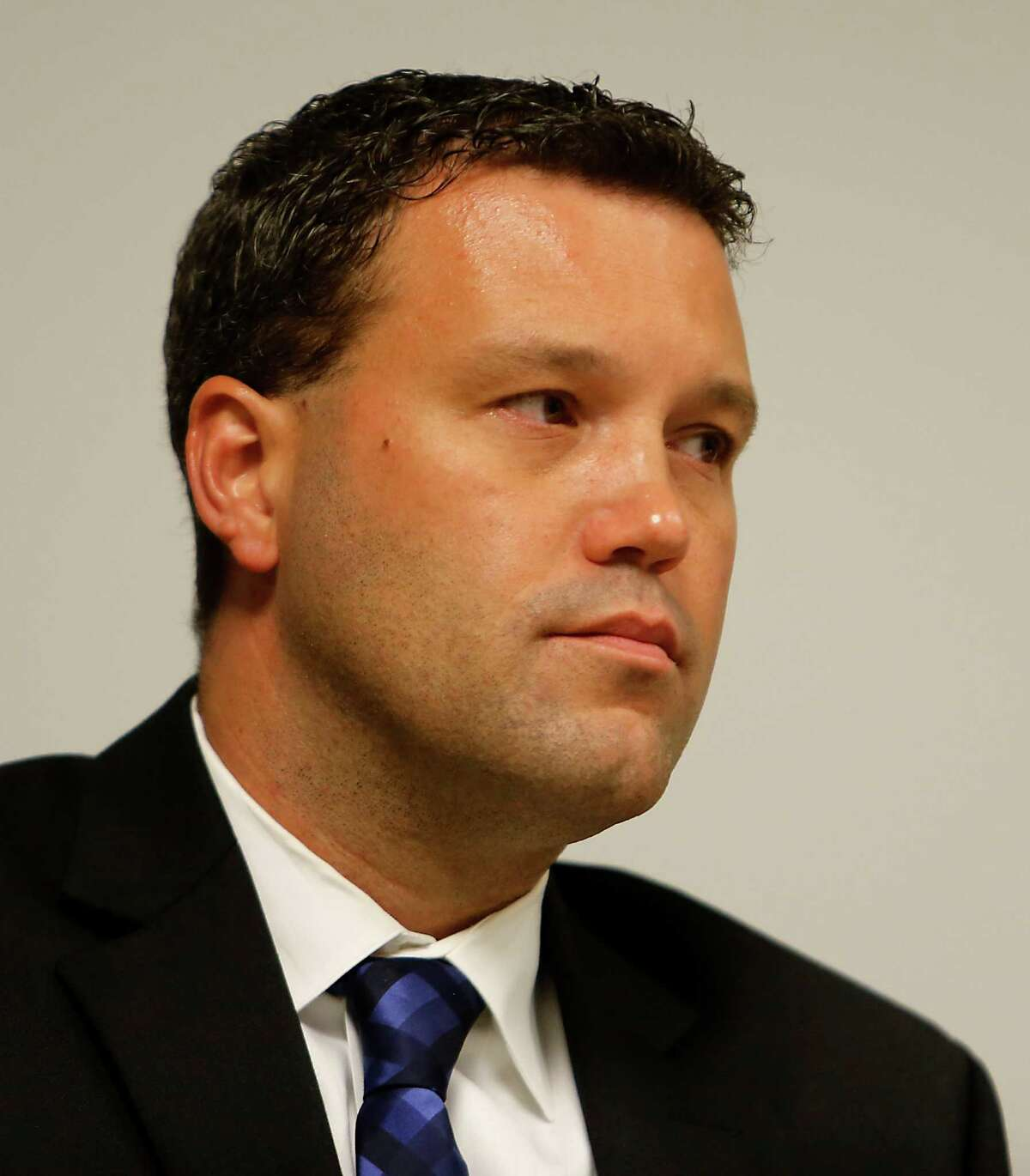 Former Houston homicide detective Sgt. Ryan Chandler during a two-day hearing to try and win his job back after HPD Chief Charles McClelland fired Chandler and disciplined seven others in early April, after a lengthy internal affairs investigation found Chandler failed to go to crime scenes, didn't interview witnesses, and took years to update case files Tuesday, Aug. 19, 2014, in Houston. ( James Nielsen / Houston Chronicle )