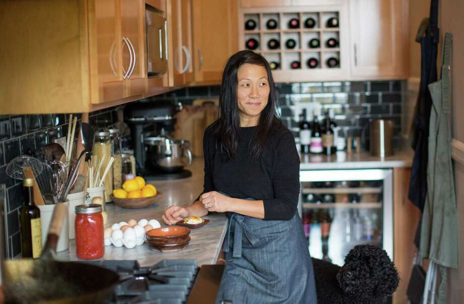 Maxine Siu makes shirred eggs with tomato sauce, heavy cream, and Gruyere, a specialty at Plow, which she owns with husband Joel Bleskacek in San Francisco. Photo: Randi Lynn Beach / Special To The Chronicle / ONLINE_YES