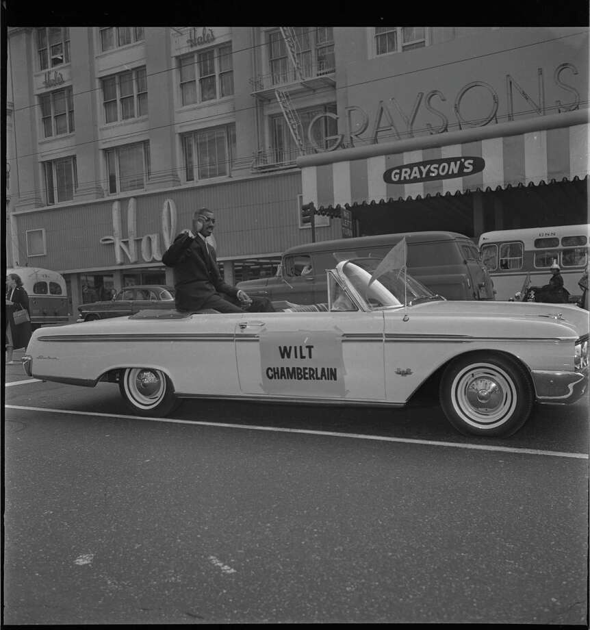 The Warriors' Wilt Chamberlain, shown in a parade, was traded to Philadelphia in 1965. / ONLINE_YES