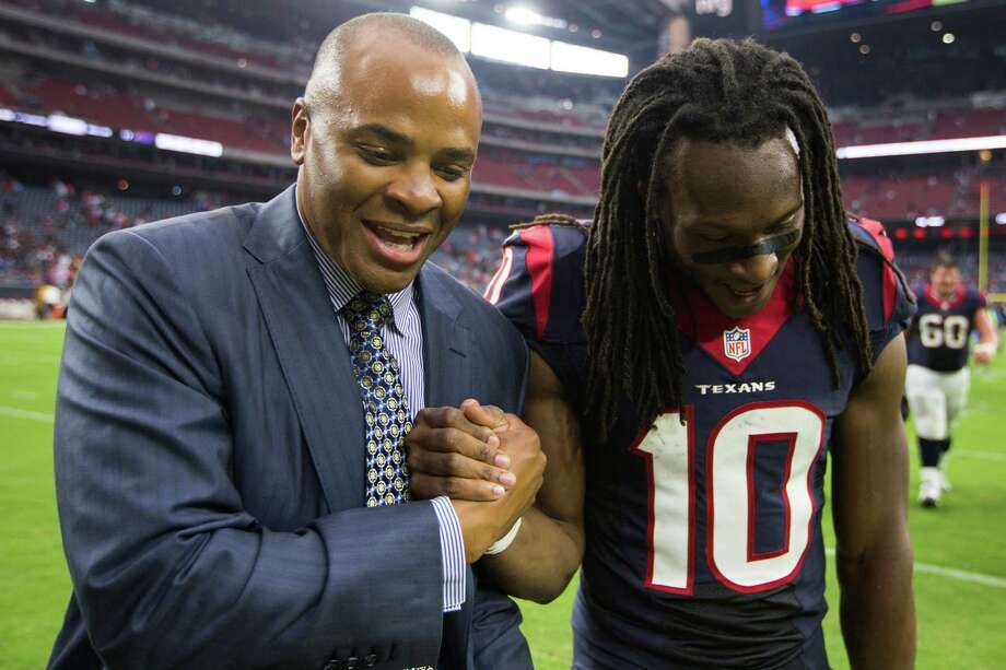 Houston Texans general manager Rick Smith, left, shakes hands with wide receiver DeAndre Hopkins (10) as they come off the field after the Texans beat the Bills in an NFL football game at NRG Stadium on Sunday, Sept. 28, 2014, in Houston. ( Brett Coomer / Houston Chronicle ) Photo: Brett Coomer, Staff / © 2014  Houston Chronicle