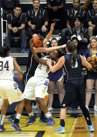 UAlbany's Imani Tate fights for a defensive rebound during their America East Women's basketball game against New Hampshire at the SEFCU Arena on Wednesday Jan. 7, 2015 in Albany, N.Y. (Michael P. Farrell/Times Union) Photo: Michael P. Farrell / 00030097A