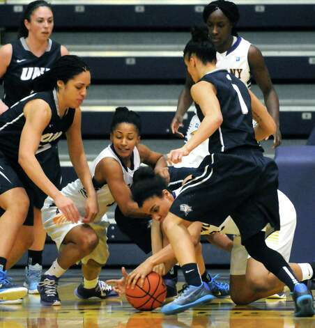 UAlbany and New Hampshire fight for a loose ball during their America East Women's basketball at the SEFCU Arena on Wednesday Jan. 7, 2015 in Albany, N.Y. (Michael P. Farrell/Times Union) Photo: Michael P. Farrell / 00030097A
