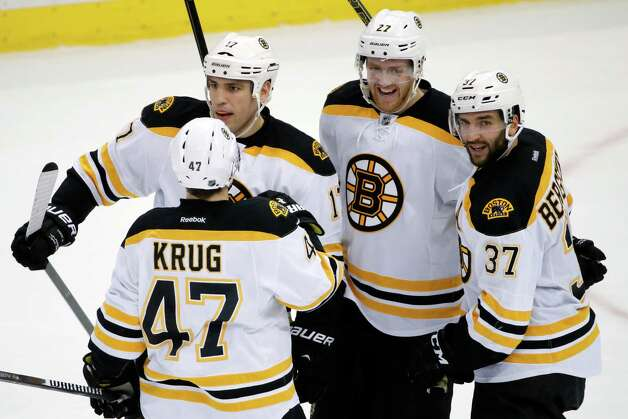 Boston Bruins' Patrice Bergeron (37) celebrates his overtime goal during an NHL hockey game against the Pittsburgh Penguins in Pittsburgh  Wednesday, Jan. 7, 2015. The Bruins won 3-2. (AP Photo/Gene J. Puskar) ORG XMIT: PAGP116 Photo: Gene J. Puskar / AP
