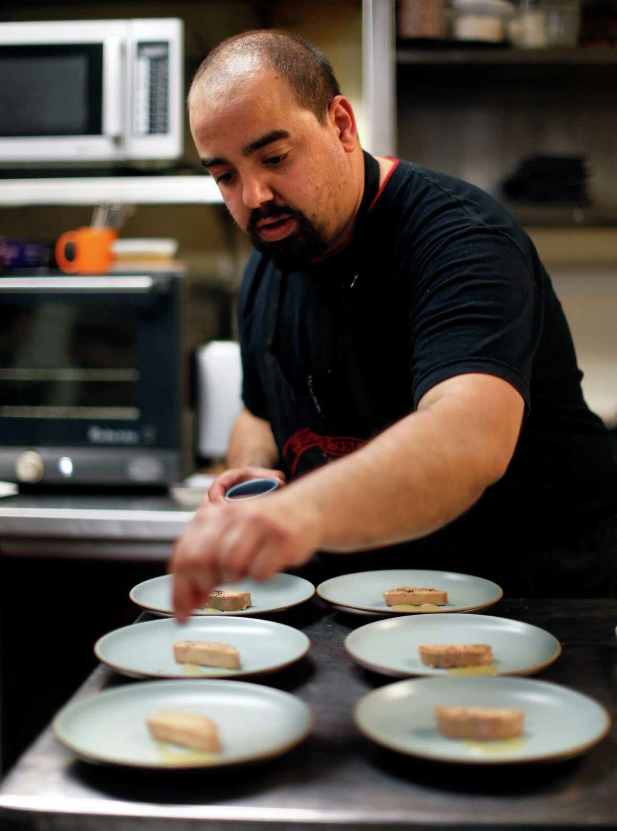 Manny Castrillo prepares foie gras torchon with jerk spices and guava jelly at Dirty Habit in San Francisco on Wednesday.