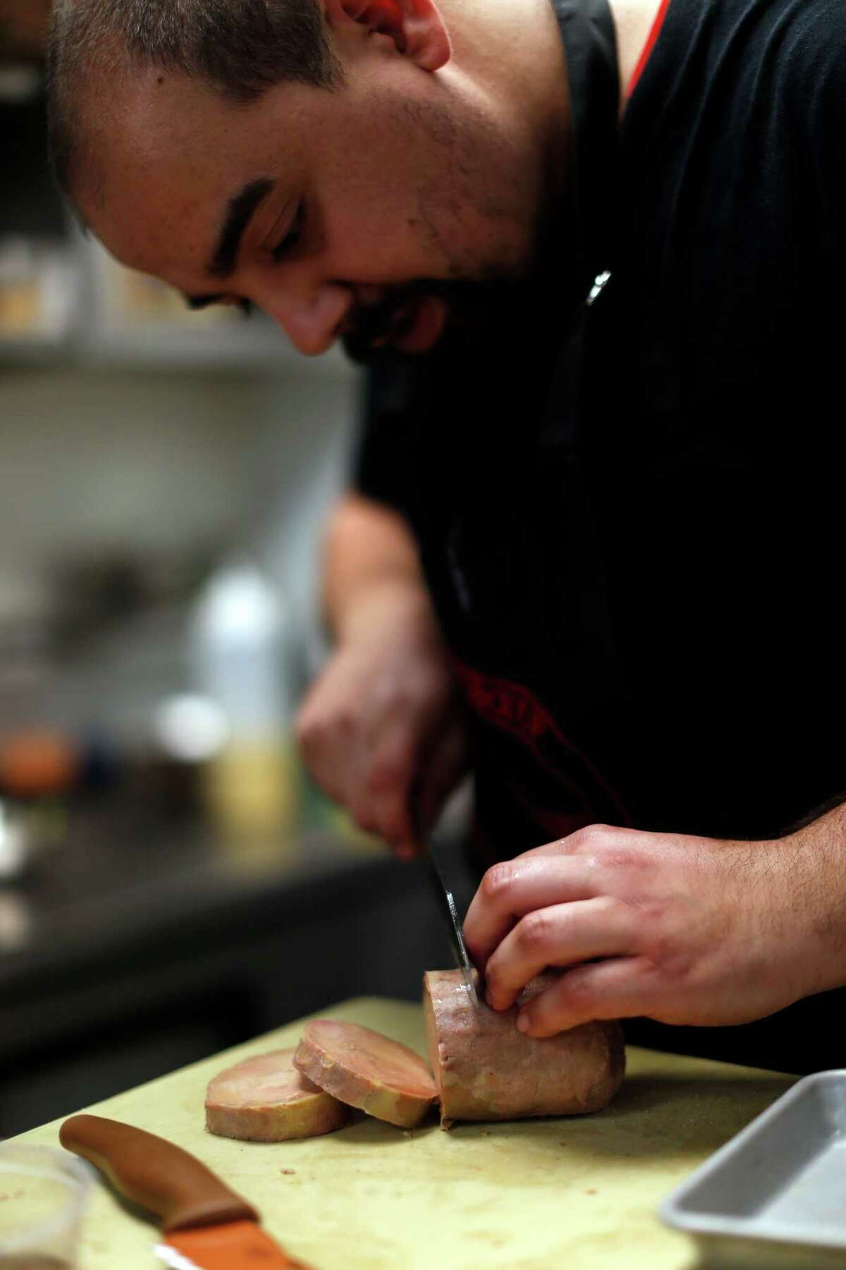 Manny Castrillo slices foie gras at Dirty Habit in San Francisco on Wednesday.