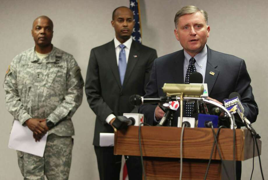 Douglas Lindquist, FBI Special Agent in Charge of the El Paso office, right, speaks during a news conference Wednesday, Jan. 7, 2015, in El Paso, Texas. The FBI identified the gunman in Tuesday's shooting as Jerry Serrato, who was medically discharged from the Army in 2009 after serving in Iraq two years earlier. (AP Photo/The El Paso Times, Victor Calzada) Photo: Victor Calzada, Associated Press / El Paso Times