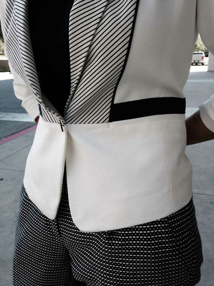 Fran Martinez loves to mix prints and patterns. Witness her cropped one-button Ann Taylor color blocked and striped jacket that pairs perfectly with cream and black trousers from The Limited. Her large dial Guess blinged watch and Betsey Johnson earrings add some pizzazz to her relaxed and classy look. And we're loving her pulled backed hair in a chic low chignon. Photo: San Antonio Express-News / San Antonio Express-News