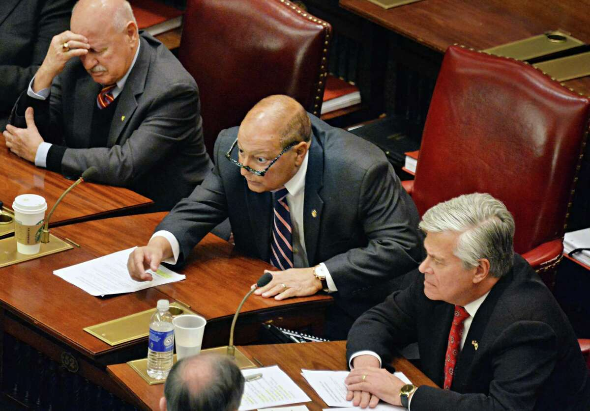 Senators Ken LaValle, left, Tom Libous, center, and GOP leader Dean Skelos, attend the Senate's first session of the new year Wednesday, Jan. 7, 2015, in Albany, N.Y. (John Carl D'Annibale / Times Union)