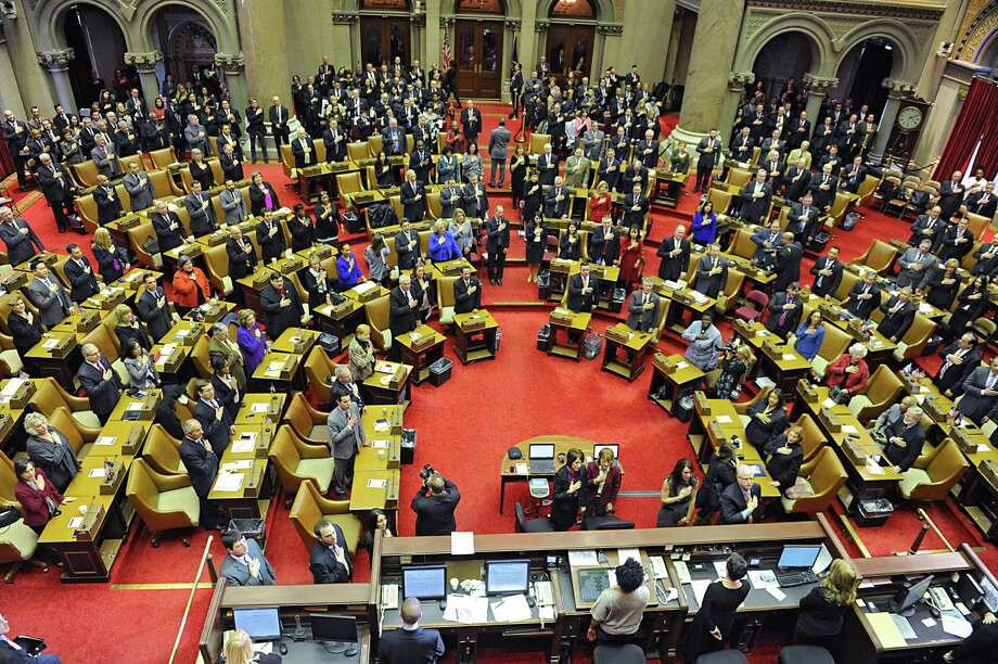 Assembly members take an oath during the opening ceremonies in the Assembly Chamber at the Capitol on Wednesday, Jan. 7, 2015 in Albany, N.Y. (Lori Van Buren / Times Union) Photo: Lori Van Buren / 00030091C