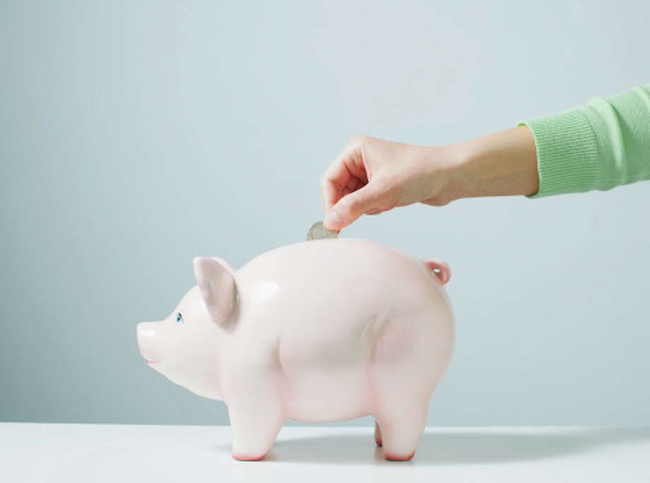 Spend less save more7 percent of Americans making resolutions for 2016 say they want to spend less and save more, according to a recent Marist Poll.  Photo: PM Images, Getty Images / (c) PM Images