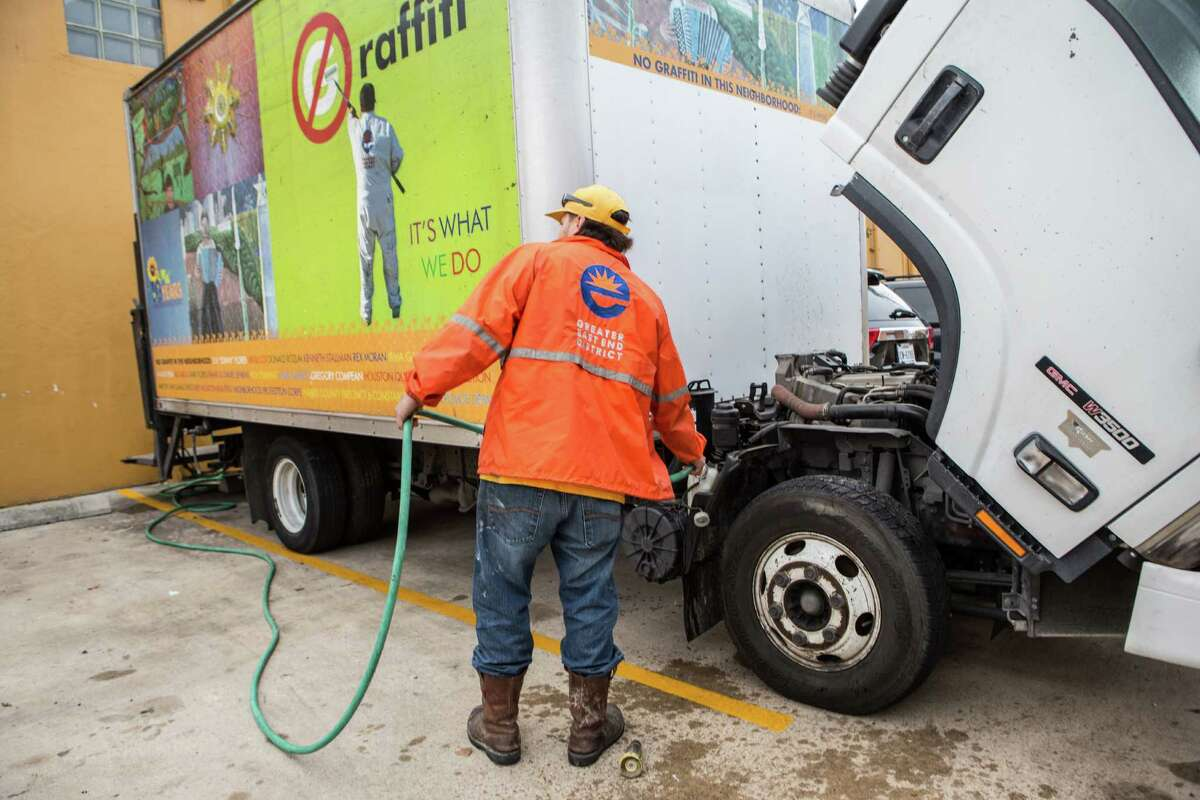 Francisco Gomez does maintenance on his truck before he heads out to do graffiti clean up for the Greater East End District Graffiti Abatement Program last month.