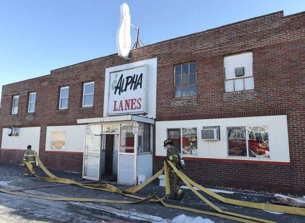 A fire broke out Thursday morning, Jan. 8, 2015, at the Alpha Recreation bowling alley in Troy after workers tried to thaw pipes. (Skip Dickstein/Times Union)