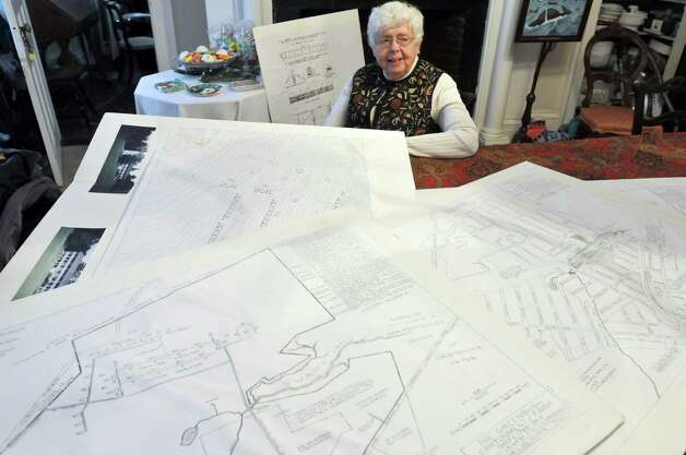 Home owner Carol Orvis sits in her home, a former military barracks, as she shows some of the maps of the layout of the Greenbush Cantonment military barracks.  Photograph taken on Tuesday, Dec. 10, 2013 in East Greenbush, NY.    (Paul Buckowski / Times Union) Photo: PAUL BUCKOWSKI / adv_unknownsoldier