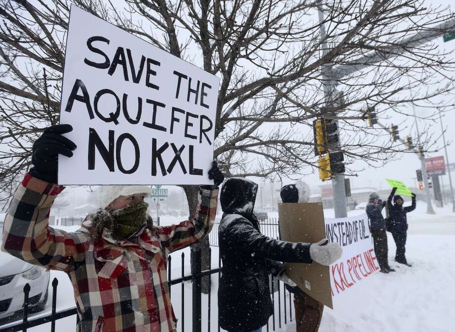 Valerie Schonewill and several others protested the Keystone XL pipeline in Sioux Falls, S.D., on  Jan 5.  Photo: Elisha Page, Associated Press