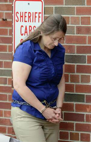 Lydia Salce exits a sheriff's cruiser before she enters the Saratoga County Courthouse in Ballston Spa, N.Y. June 26, 2012 for opening arguments in her attempted murder trial. (Skip Dickstein / Times Union archive) Photo: SKIP DICKSTEIN / 00018239A