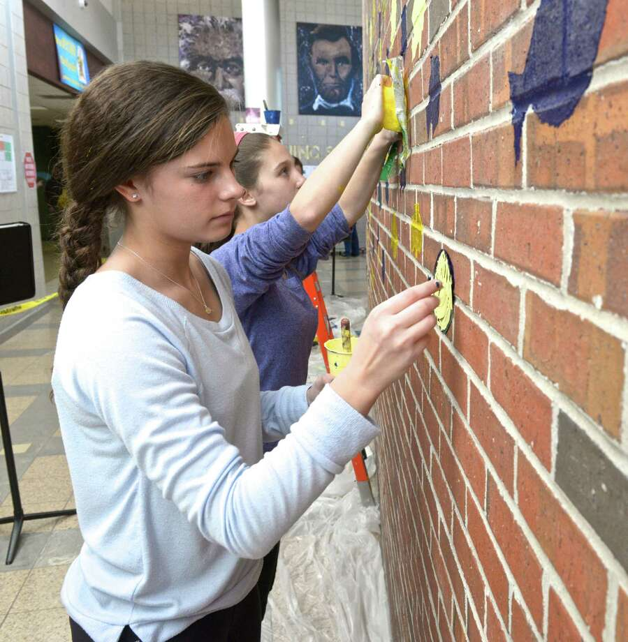"Avery Buckanavage, 14, left, and Rebecca Cohen, 13, work on ""School of Fish"", one of the art works being created by Scotts Ridge Middle School eighth grade students who are collaborating with Aldrich Museum of Contemporary Art artist in residence David Scanavino on a week long project called ""Process versus Product: Why Do We Create"" by creating art pieces in multiple locations inside the school. Thursday, January 8, 2015, in Ridgefield, Conn. Photo: H John Voorhees III / The News-Times"