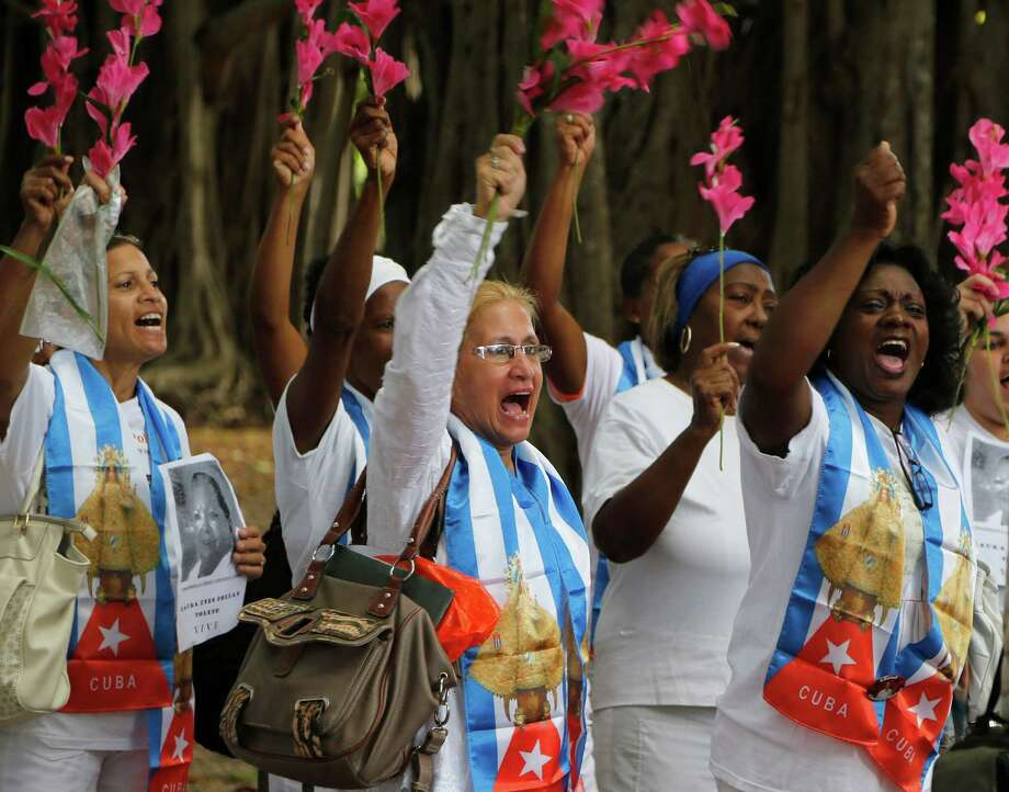 Members of the Cuban dissident group Ladies in White, protest in Havana last month. Photo: Desmond Boylan / Associated Press / AP