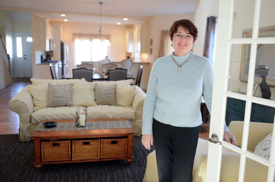 Kathy Ekstrom, executive director of Meadow Brook Estates, stands in a model home Thursday, Jan. 8, 2015, in the over-55 complex in Oxford, Conn. Photo: Autumn Driscoll / Connecticut Post
