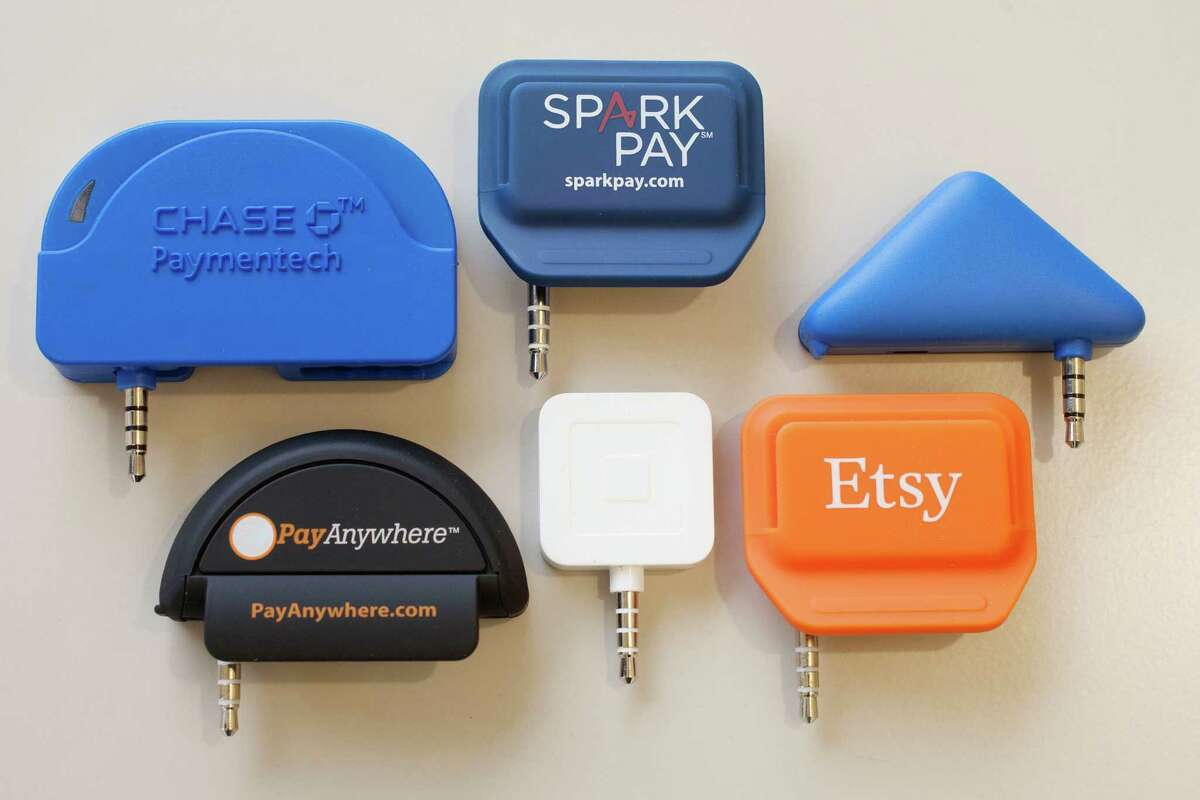 Card readers (clockwise from top left) from Chase, Spark Pay, PayPal, Etsy, Square and Pay Anywhere.