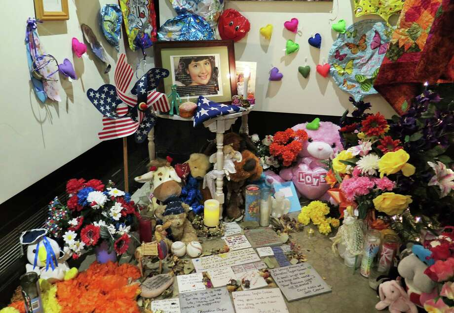 Items left at a memorial to the Tucson shooting victims are on display at the Arizona History Museum. Photo: Astrid Galván / Associated Press / AP
