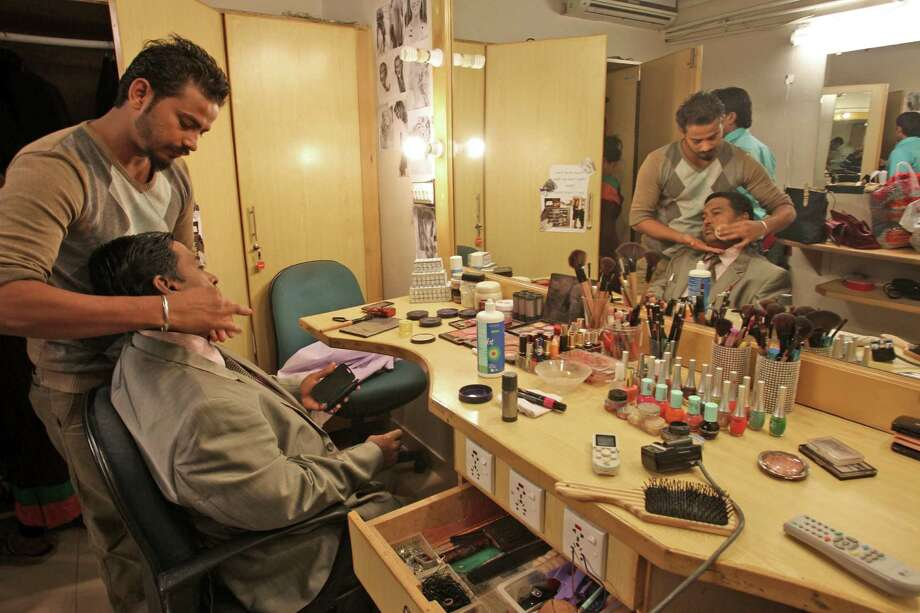 "Pakistani Dr. Nadeem Uddin Siddiqui has makeup applied on his face before starting a television call-in show called ""Clinic Online"" last month on private satellite channel HTV in Karachi, Pakistan. Photo: Fareed Khan / Associated Press / AP"