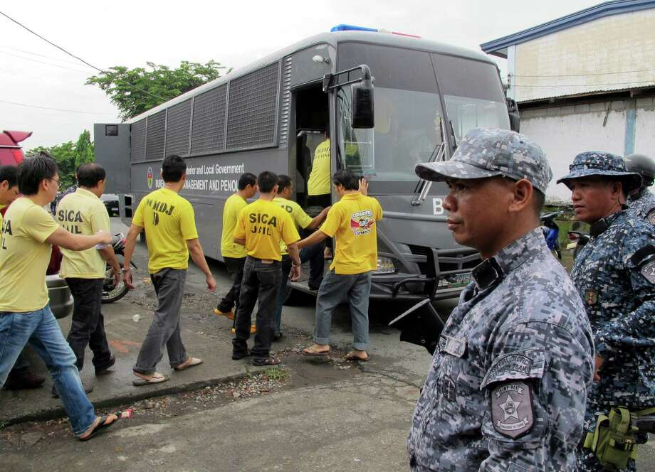 Muslim detainees board their bus to take them back to their detention following one of the reinvestigation hearings to review their cases at the the special court near their detention compound at Camp Bagong Diwa, Paranaque city, south of Manila, Philippines. In the country's dogged pursuit of terror suspects, Philippine law enforcers have made a slew of mistaken arrests. Photo: Jim Gomez / Associated Press / AP