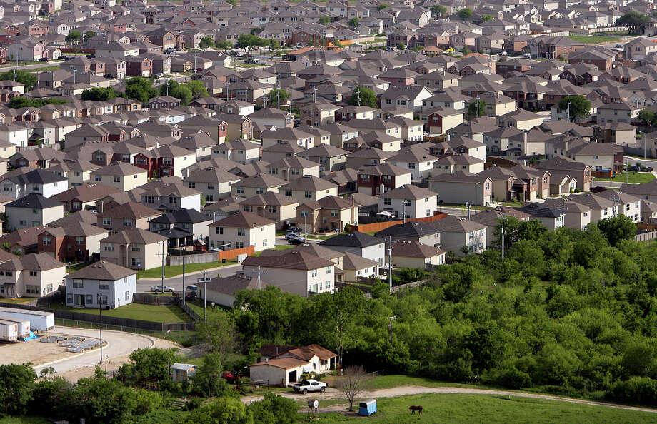 The San Antonio Board of Realtors said 22,655 homes were sold from January to November 2014, up for the first time in four years, and inventory was at 3.9 months in November, the lowest mark in years. Photo: Express-News File Photo / San Antonio Express-News