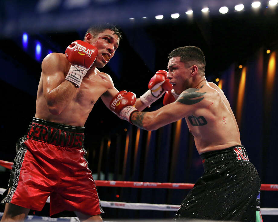 Luis Cervantes (left) and Ivan Najera exchange punches during their lightweight bout on Nov. 15, 2014 at the Alamodome. Photo: Edward A. Ornelas /San Antonio Express-News / © 2014 San Antonio Express-News