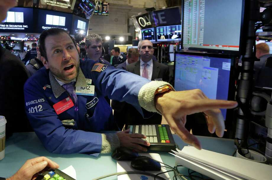 Specialist Michael Pistillo saw stocks do extremely well at the New York Stock Exchange. Photo: Richard Drew / Associated Press / AP