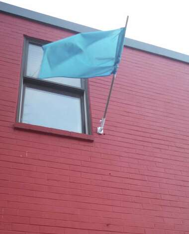 A blue flag hangs from Joseph's House & Shelter, 74 Ferry St., Troy, whenever a Code Blue is in effect for severe weather. (Photo courtesy of Joseph's House & Shelter)