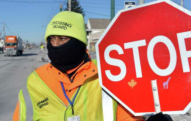 City of Schenectady crossing guard Jimmy Williams copes with this morning's below zero temperatures at his post on State Street Thursday Jan. 8, 2015, in Schenectady.  (John Carl D'Annibale / Times Union) Photo: John Carl D'Annibale / 00030121A