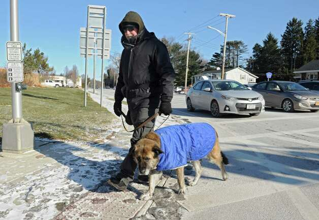 Retired UAlbany policeman Mike Lasceo of Guilderland and his dog Jake are both bundled up as they cross Fuller Rd. and Western Ave. on Thursday, Jan. 8, 2015 in Guilderland, N.Y.  (Lori Van Buren / Times Union) Photo: Lori Van Buren / 00030121A