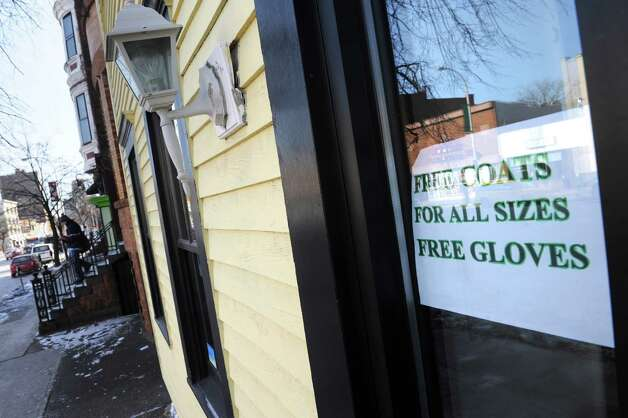 A sign offering free hats and gloves outside the Homeless and Travelers Aid Society of Albany on Thursday Jan. 8, 2015 in Albany, N.Y. (Michael P. Farrell/Times Union) Photo: Michael P. Farrell / 00030121A