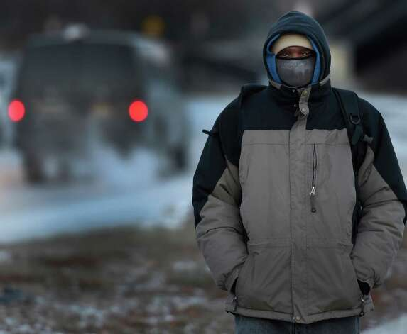 Frank Montgomery walks to work on North Manning Boulevard in the extreme cold Thursday morning, Jan. 8, 2015, in Albany, N.Y.  (Skip Dickstein/Times Union) Photo: SKIP DICKSTEIN