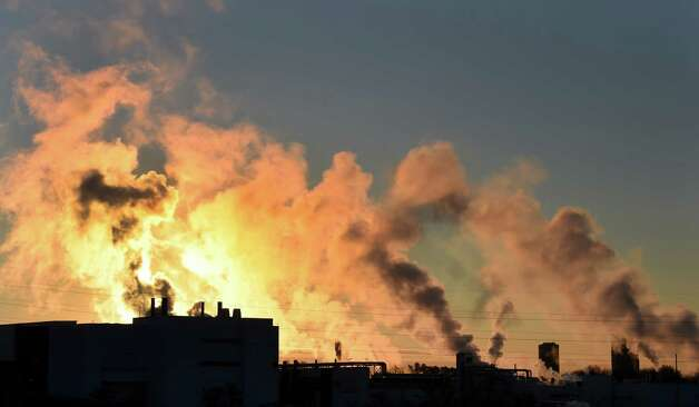 Extreme cold intensifies the clouds of steam from various stacks at the College of Nanoscale Sciences and Engineering at SUNY Polytechnic Institute Thursday morning, Jan. 8, 2015, in Albany, N.Y.  (Skip Dickstein/Times Union) Photo: SKIP DICKSTEIN