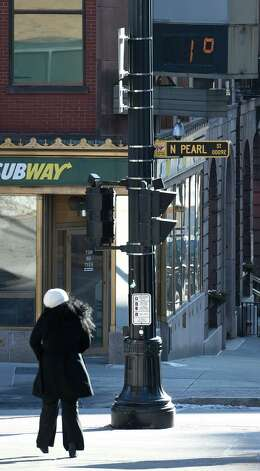 The sign above the corner of North Pearl and State streets shows 1 degree Thursday morning  Jan. 8, 2015 in Albany, N.Y.  (Skip Dickstein/Times Union) Photo: SKIP DICKSTEIN