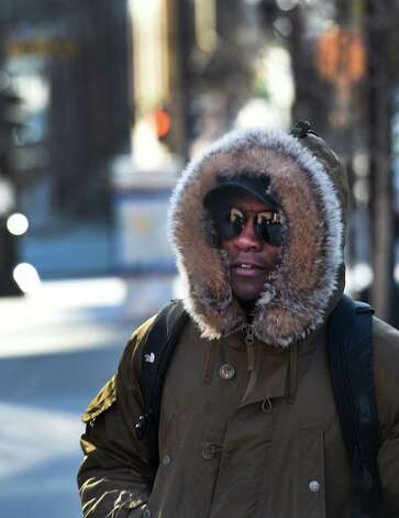Shedrack Nayebare formerly of Uganda walks to work on lower State Street in the extreme cold Thursday morning  Jan. 8, 2015 in Albany, N.Y.  (Skip Dickstein/Times Union) Photo: SKIP DICKSTEIN