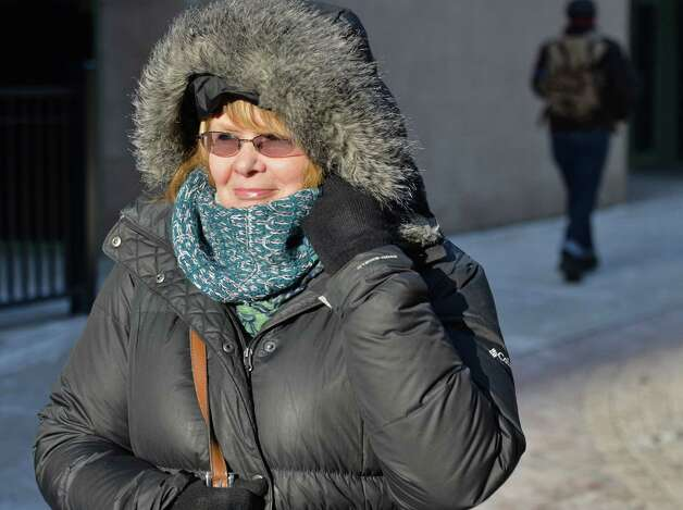 Linda Scott of Schenectady bundles up against the cold as she makes her way back to work after lunch Thursday Jan. 8, 2015, in Schenectady, NY.  (John Carl D'Annibale / Times Union) Photo: John Carl D'Annibale / 00030121A