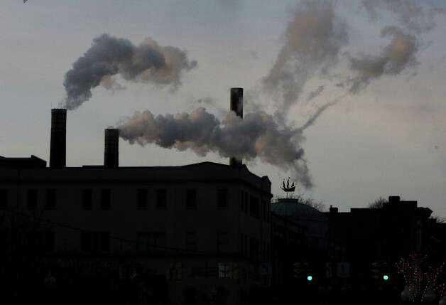 Smoke is seen coming out of smokestacks on a building on a cold Thursday, Jan. 8, 2015 in Albany, N.Y.  (Lori Van Buren / Times Union) Photo: Lori Van Buren / 00030121A
