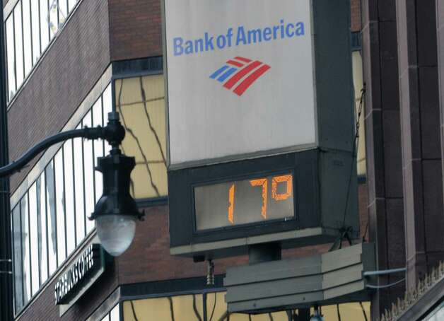 A thermometer clock on State St. shows a temperature of 17 degrees on a cold Thursday, Jan. 8, 2015 in Albany, N.Y.  (Lori Van Buren / Times Union) Photo: Lori Van Buren / 00030121A