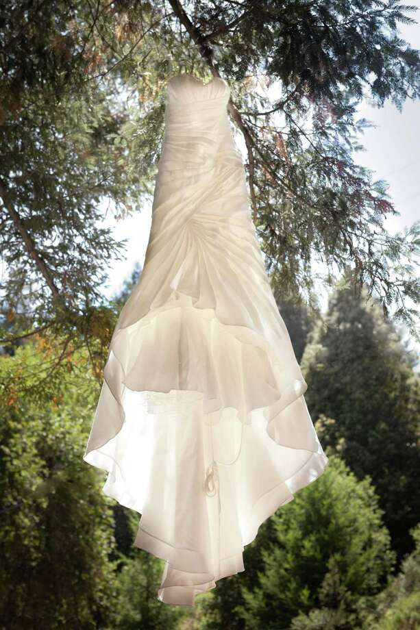 The wedding gown of San Francisco Ballet soloist Jennifer Stahl, who wed Eric Weitz on Aug. 9, 2014, was by Coan Couture, purchased at Bridal Images in San Francisco's Hayes Valley. Photo: Ian Martin Wedding Photojournalism / ONLINE_YES