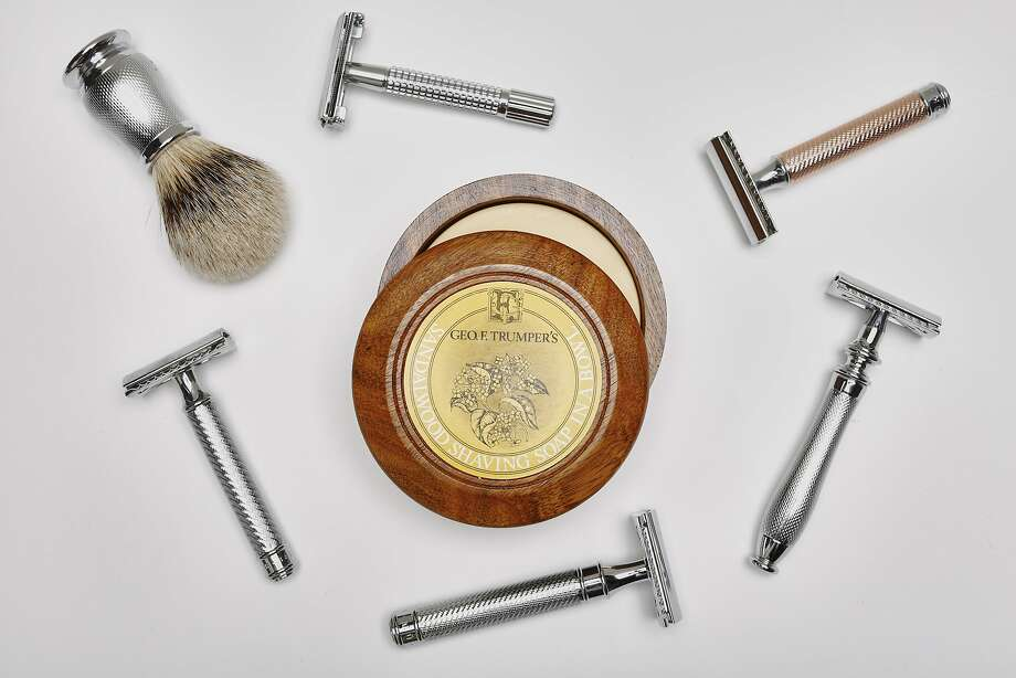 Mens' shaving products are seen on Wednesday, Jan. 7, 2015 in San Francisco, Calif.  Clockwise from the brush: Van der Hagen Traditional Safety Razor, $19.99, www.target.com;  The Art of Shaving Rose Gold Safety Razor, $100, www.theartofshaving.com;  Edwin Jagger Chatsworth Barley Double Edge Safety Razor, $150, www.fellowbarber.com;  Mühle R89 Grande Safety Razor, $75, www.theartofshaving.com;  Baxter of California Safety Razor, $60, www.baxterofcalifornia.com  Center: Geo. F. Trumper Sandalwood Hard Shave Soap in Wooden Bowl, $30, www.fellowbarber.com Photo: Russell Yip, The Chronicle