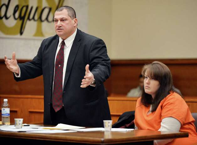 Defense attorney Mark Caruso, left, and Tina Karuzas  during Karuzas' sentencing in Schenectady County Court Friday Jan. 18, 2013, for the December 2011 fatal stabbing of her neighbor, Latoya Ebron, over loud music. (John Carl D'Annibale / Times Union archive) Photo: John Carl D'Annibale / 00020787A