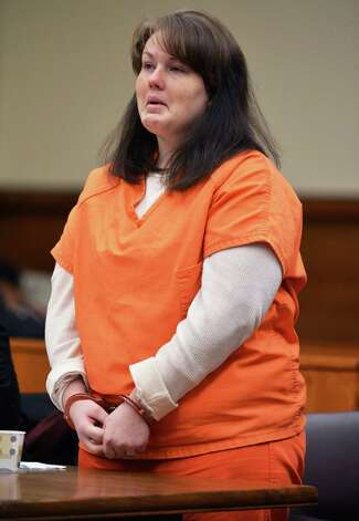 Tina Karuzas addresses the court during her sentencing in Schenectady County Court Friday Jan. 18, 2013, for the December 2011 fatal stabbing of her neighbor, Latoya Ebron, over loud music. (John Carl D'Annibale / Times Union archive) Photo: John Carl D'Annibale / 00020787A