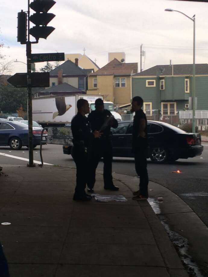 Oakland police question a homeless man found in possession of an apparent skull at an encampment at 7th and Castro streets on Jan. 8, 2015 Photo: Henry K. Lee / ONLINE_YES