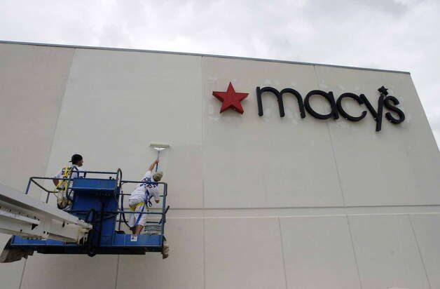 Workers from CertaPro Painters of Rhode Island apply a fresh coat of paint on the side of the Macy's store in the Rotterdam Square Mall in this 2006 file photo. (Paul Buckowski/Times Union archive) ORG XMIT: MER2015010817441861 Photo: Paul Buckowski / Albany Times Union
