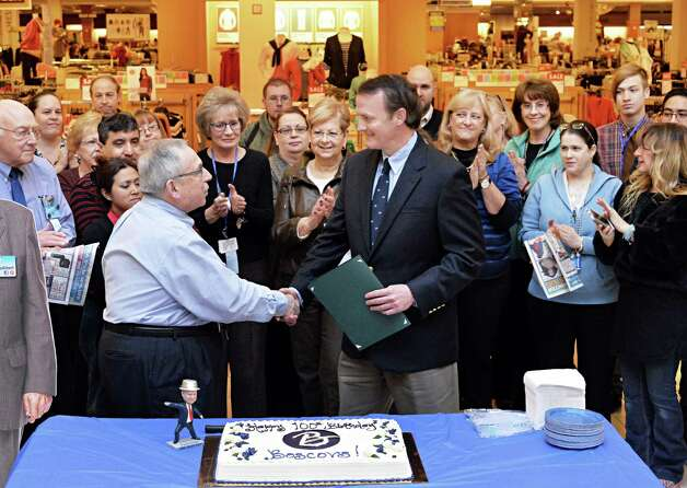 Boscov's store manager Jay Janowsky, left, receives congratulations from Clifton Park Supervisor Phil Barrett on the company's 100th year in business during a ceremony at the Clifton Country Mall Boscov's store Thursday Jan. 8, 2015, in Clifton Park, NY.  (John Carl D'Annibale / Times Union) Photo: John Carl D'Annibale / 00030116A