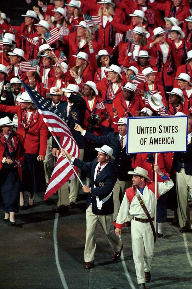 In a September 2000 file image from the opening ceremony for the Sydney 2000 Summer Olympic Games, flag-bearer and kayaker Cliff Meidl leads the way. (Paul Morse/Los Angeles Times/TNS) Photo: Paul Morse / McClatchy-Tribune News Service / Los Angeles Times