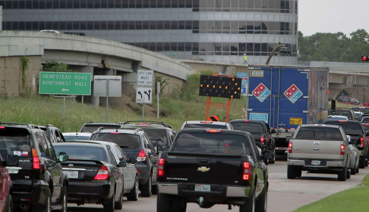Traffic backs on Loop 610 eastbound frontage road headed west near U.S. 290 as construction work continues on July 12, 2014.