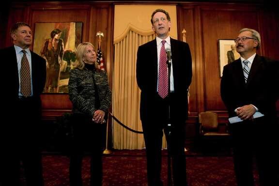 San Francisco 2024 Olympic committee members Steve Strandberg (left), Anne Warner Cribbs, Giants CEO Larry Baer and Mayor Ed Lee at S.F. City Hall speak after losing the bid to host the Summer Games.
